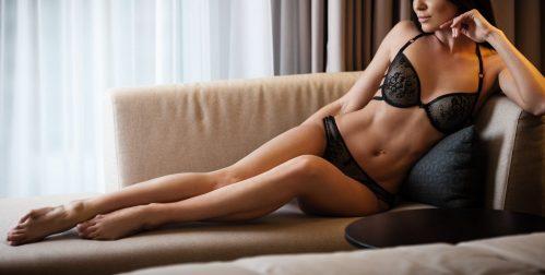 Victoria sat on a chair in black underwear