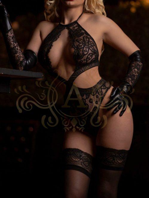 Zara wearing a black lace bra